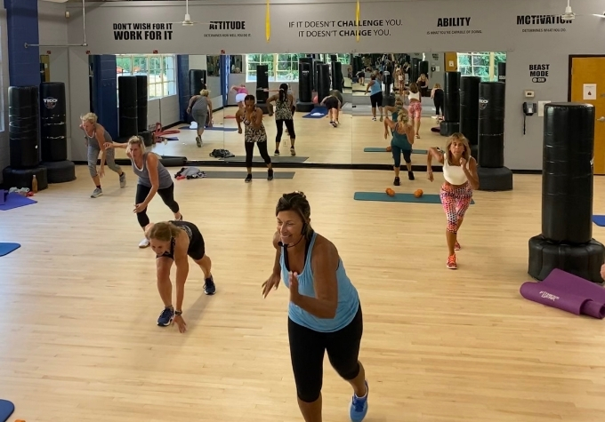 Research shows that people who take group activity classes are more likely to consistently show up for their workouts.